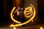 mN8Fx troupe members GlitterGirl and Hunter adeptly move through fire at the Temple of Poi 2006 Fire Dancing Expo now on DVD