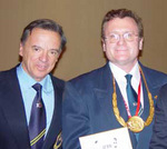 Dr. Goldman (right), World Medical Chairman, with Dr. Rafael Santonja-Gomez (left), International President, both of the International Sports Federation