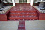 Brick patterned entryway.