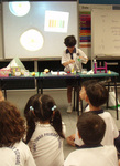 Ainan Celeste Cawley, six, demonstrates a chemical reaction