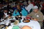 Veterans Enjoying A Meal at 14th Annual Veterans Holiday Celebration