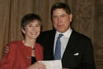 Alberto Ibarguen, President, Knight Foundation, presents Rachel Blechman, President, Funding Arts Network, with $100,000 check.