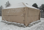 The shelter is able to withstand a snow load of 10 pounds per square foot for a minimum of 12 hours.
