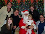 "STAR 99.1 Morning Show along with one of their ""Christmas Prayers"" families gets a visit from ""Santa"""