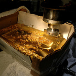 Northwest Territorial Mint experts shave nearly 100 ounces from bar to meet specified weight.