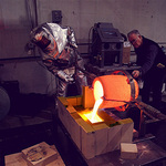 Northwest Territorial Mint's experts pour 520 Troy ounces of molten gold.
