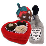 The Casanova Toy Set includes an irresistible plush heart-shaped chocolate candy box, scrumptious chocolate dipped strawberry and a bottle of Dog Perignon. What furry fashionista could resist?!