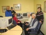 Computer donations in action. Recycled computers in eldery home in Calgary, Alberta. Allowing the elderly residents to access the internet.