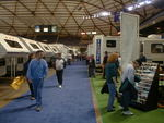 RV shows are excellent places to learn about RVs. But buying a recreational vehicle on impulse is not a good idea.