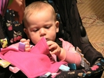 Joely Fisher's little girl, True, is fascinated by the tags on her Taggies blanket.