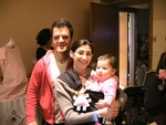 """Kevin Weisman (""""Alias"""") and wife Jodi have attached a Take-A-Long Taggies to daughter  Maya's sling."""