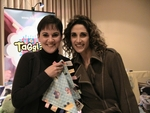 Actress Melina Kanakaredes admires the soft comfort of Taggies blankets.