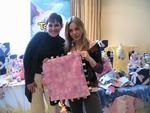 Actress Shirly Brener is seriously impressed by the quality of the workmanship in her Taggies blanket.