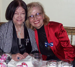Lillian Booth (left) and her long term friend Mira Zivkovich (right), who organized the event, share a loving moment together.