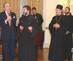 The attendees include dignitaries, clergy and honored guests, (From Left to Right) Misha Dabich, the Very Reverend Djokan Majstorovic and His Grace Bishop Dr. Mitrophan (right).
