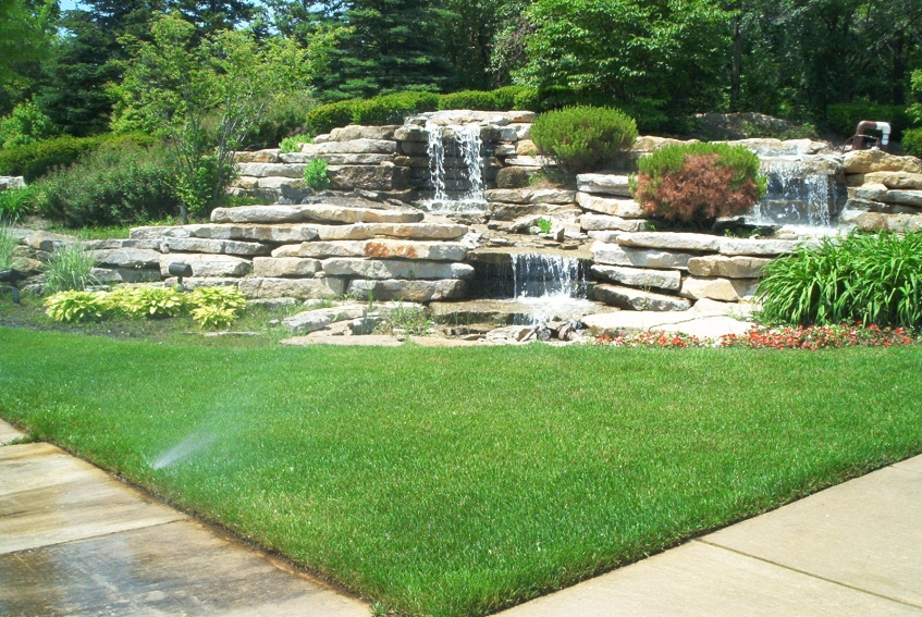 Waterfall for nw corner of lot corner lot landscaping for Corner lot landscaping pictures
