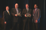 IAOP Chairman Michael Corbett (left) and Chair of IAOP's Advocacy and Outreach Committee Atul Vashistha (right) present Kevin Campbell and Ron Kifer with the Outsourcing Hall of Fame Award at The 2007 Outsourcing World Summit in Las Vegas.
