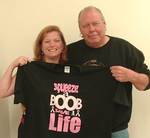 Clayton and Wendy Makepeace with t-shirt up for auction to benefit the American Breast Cancer Foundation