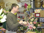 Mark, the floral designer prepares bouquet.