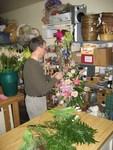 Vann Jernigan Florist designer Mark prepares arrangement.