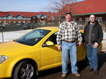 Todd Rockhill and his friend, Mike, are pictured in front of the new Pontiac G5 Todd won at Lake of the Torches Resort Casino.