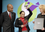 Patrick Gaston, President of Verizon Foundation, Dr. Sherry Johnson--holding her award and a handful of RealeBooks.