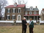 Veterinarians Dr. Richard Detwiler and Dr. Max Herman review literature.  The newly purchased Museum house is in the background