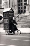 Father Joseph (aka Joey Skaggs) peddles Portofess, his portable confessional booth