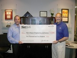 Joel Trammell, CEO of NetQoS, Inc. Presents Scholarship Check to Dr. Bruce Willson, Assistant Dean for Development and Administration, College of Engineering and Science, Louisiana Tech University.
