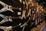 Wall of Dean Guitars for Six String Masterpiece Auction