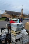 2006 Earth Keeper Clean Sweep: Volunteers from several faiths and the boy scouts stack old computers on Earth Day 2006 at the Messiah Lutheran Church in Marquette, one of two dozen collection sites across northern Michigan. Over 320 tons was collected during the second annual Earth Keeper Clean Sweep. (Photo by Greg Peterson)