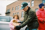2005 Earth Keeper Clean Sweep: Six-year-old Grace Feliz of Marquette proudly turns in batteries and other household hazardous waste to site coordinator Bill Rigby on Earth Day 2005 at the First Presbyterian Church collection site in Marquette. Feliz was accompanied by her mother, Tracy, during the first annual Earth Keeper Clean Sweep. The Cherry Creek Elementary School kindergarten student (in 2005), who attends the First United Methodist Church, said she was studying recycling in class. The public turned in 45 tons of household poisons, drain cleaners, vehicle batteries and two pounds of raw liquid mercury during the first clean sweep in 2005. (Photo by Greg Peterson)