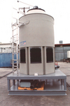 Engineered plastic cooling towers are ideal for harsh environments.  They are impervious to salt air and waste products that can often be found in the air in many industrial areas.