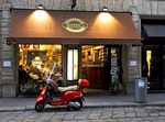 Etihad to fly to Milan - Vespa outside of a store in Milan