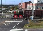 300dpi jpg. Busy Little Engine pulls a long train.