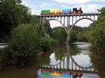 300dpi jpg. Busy Little Engine crosses a tall bridge.