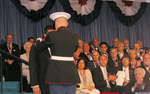 Medalist Daniel J. Thomas is awarded his 2007 Ellis Island Medal of Honor by a military officer