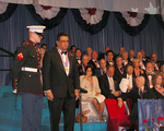 Medalist Daniel J. Thomas stands proudly with military officer after receiving 2007 Ellis Island Medal of Honor