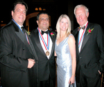 2007 Ellis Island Medalists: Mitchell Modell, CEO of Modell's Sporting Goods, Dr. Daniel J. Thomas and Harvey MacKay, Chairman of MacKay Envelope Co. proudly stand with Mrs. Thomas