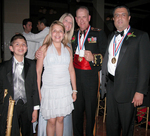 Medalists: Col. R.L. Grabowski, USMC Commanding Officer, First Marine Corp District and Dr. Daniel J. Thomas with his wife, Dr. Donna Thomas, and children Alexandria and Preston