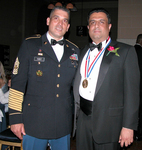 Commander Caez of the US Army and Medalist Dr. Daniel Thomas after Ellis Island Award Ceremony