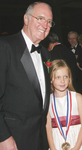 Obren Brian Gerich sharing moments of joy and his Ellis Island Medal of Honor with his beloved granddaughter