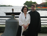 V. Rev.Djokan Majstorovic and his wife Miriana Majstorovic at the historical grounds of Ellis Island