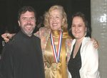 Medalist Mira Zivkovich with Father Majstorovic and his wife Miriana at the banquet that took place in the Great Hall on Ellis Island