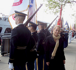 MZI CEO Mira Zivkovich's Serbian assistant Ana Lazic standing with the Honor Guards