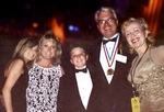 Medalist Thomas Stankovich and family with MZI CEO Mira Zivkovich (right)