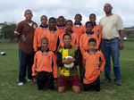 Children in Stellenbosch South Africa wearing their donated Stanno football kits