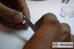 Artisan hand-selecting diamonds for ring setting.