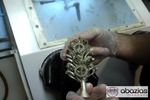 Metal ring tree pulled from casting ovens.