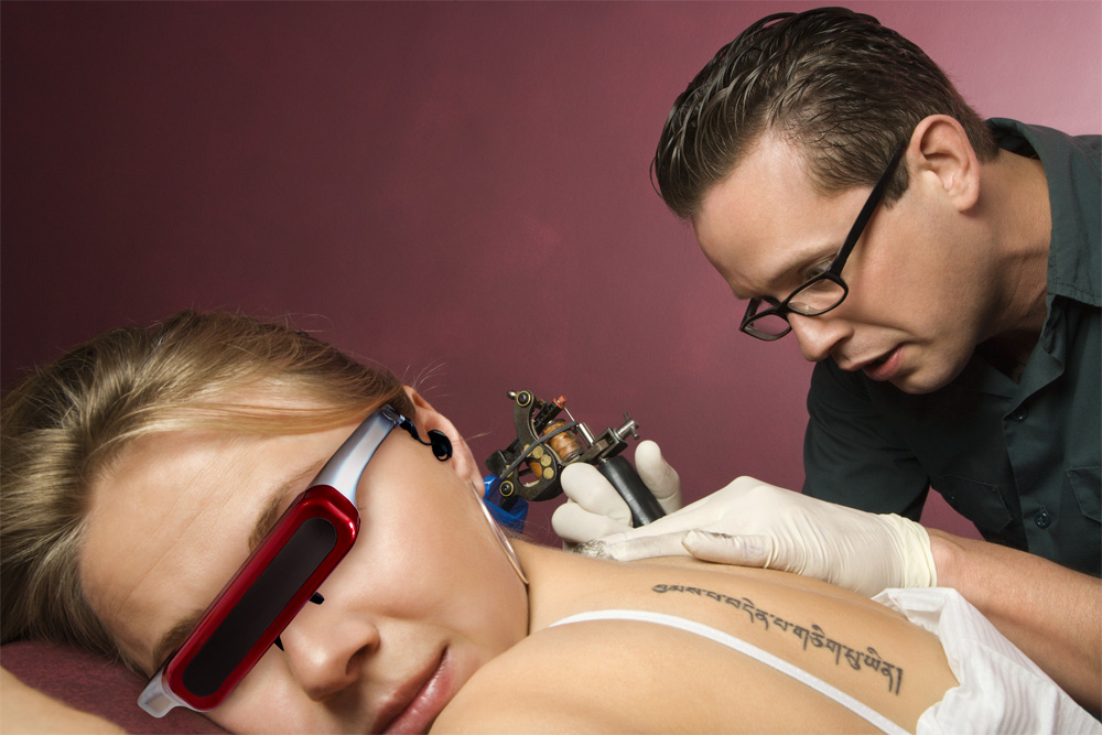 300 DPI photo of pain distraction with video glasses at the tattoo shop